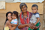 """THIS PHOTO IS AVAILABLE AS A PRINT OR FOR PERSONAL USE. CLICK ON """"ADD TO CART"""" TO SEE PRICING OPTIONS.   Ganime Makmovida, 68, poses with members of her family in the largely Roma neighborhood of Gorno Ezerovo, part of the Bulgarian city of Burgas. Residents here don't self-identify much as Roma, because of the negative connotations associated with the word, so many refer to themselves as a Turkish-speaking minority. This woman participates in the local United Methodist congregation."""
