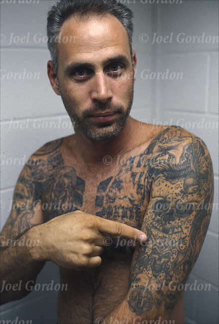 Inmate in Orange County Jail Aryan Nation swastika gang tattoos on chest