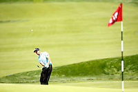 Gregory Bourdy chips in his fourth shot from outside the 18th green during the 2016 U.S. Open in Oakmont, Pennsylvania on June 18, 2016. (Photo by Jared Wickerham / DKPS)