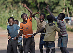 Children celebrate while playing tug of war in the Makpandu refugee camp in Southern Sudan, 44 km north of Yambio, where more that 4,000 people took refuge in late 2008 when the Lord's Resistance Army attacked their communities inside the Democratic Republic of the Congo. Attacks by the LRA inside Southern Sudan and in the neighboring DRC and Central African Republic have displaced tens of thousands of people, and many worry the attacks will increase as the government in Khartoum uses the LRA to destabilize Southern Sudan, where people are scheduled to vote on independence in January 2011. Catholic pastoral workers have accompanied the people of this camp from the beginning. NOTE: In July 2011 Southern Sudan became the independent country of South Sudan.