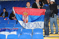 A Serbian fan proudly shows off the National flag at the Wales v Serbia FIFA World Cup 2014 Qualifier match at Cardiff City Stadium, Cardiff, Wales -Tuesday 10th Sept 2014. All images are the copyright of Jeff Thomas Photography-07837 386244-www.jaypics.photoshelter.com