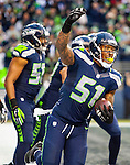 Seattle Seahawks linebacker Bruce Irvin (51) celebrates his 49-yard touchdown interception against the St. Louis Rams  during the fourth quarter  at CenturyLink Field in Seattle, Washington on December 28, 2014.  The Seahawks officially wrapped up the No. 1 seed in the NFC playoffs shortly after beating the Rams, 20-6. Despite the Cowboys and Packers also winning to finish 12-4, the Seahawks (12-4) won the multi-team tiebreaker and earned home-field advantage throughout the playoffs for the second consecutive season.  ©2014. Jim Bryant Photo. All Rights Reserved.