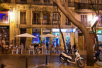 Valencia, Spain, September 2013. Nightlife in Valencia, where the people spend their evenings in the bars, reastaurants and clubs. In the middle of the Spanish Mediterranean coastline lies Valencia, a beautiful city backed by mountains and plains. The city itself is boasts beautiful architecture from the historic to avant-garde. Valencia is also famed for its art galleries and fabulous local cuisine, such as juicy Valencia oranges and traditional Spanish paella, which originated from here. A good way to explore the city is by bicycle. Photo by Frits Meyst
