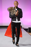 Fashion designer Edwing D'Angelo, walks the runway after the close of his Edwing D'Angelo Fall 2012 Beauty Attack collection fashion show, during Couture Fashion Week New York, February 19, 2012.