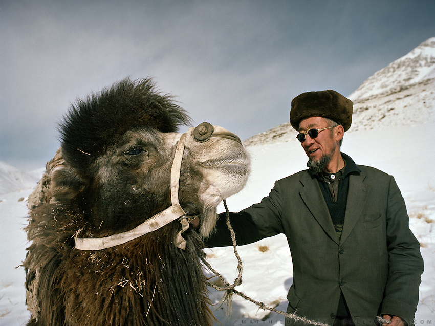 Haji Osman might be the future Khan. With his pride, a 15 year ols Bactrian camel..Campment of Tshar Tash (Haji Osman's camp), in the Wakhjir valley, at the source of the Oxus..Winter expedition through the Wakhan Corridor and into the Afghan Pamir mountains, to document the life of the Afghan Kyrgyz tribe. January/February 2008. Afghanistan