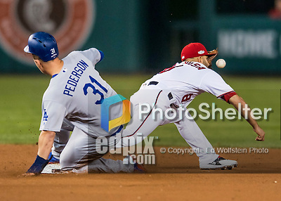 13 October 2016: Washington Nationals shortstop Danny Espinosa is unable to get Joc Pederson out at second in the 5th inning, Game 5, of the NLDS against the Los Angeles Dodgers at Nationals Park in Washington, DC. The Dodgers edged out the Nationals 4-3, to take Game 5 of the Series, 3 games to 2, and move on to the National League Championship Series against the Chicago Cubs. Mandatory Credit: Ed Wolfstein Photo *** RAW (NEF) Image File Available ***