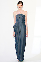 Model wears a draped bandeau gown, and sequin necklace, by Fiona Cibani, for the Ports 1961 Pre-Fall 2011 L'heure bleue collection, December 8, 2010.
