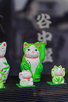 """Cat figures in the window of a shop, Yanaka, Tokyo, Japan, April 19, 2012. Yanaka is part of Tokyo's """"shitamachi"""" historic working class wards. Recently it has become popular with Japanese and foreign tourists for its many temples, shops, restaurants and relaxed atmosphere."""