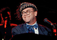 "Jul 09, 1988 - Los Angeles, California, USA - British pop singer Elton John performs at the ""For the Love of Children"" benefit for children with AIDS and other serious illnesses, at the Century Plaza Hotel in Los Angeles, July 9, 1988. .(Credit Image: © Alan Greth)"