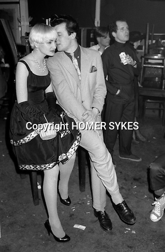 Blitz Kids New Romantics at The Blitz Club Covent Garden, London, England 1980.<br /> <br /> Judy Harrison (nee Scadding) with whispering gent, writer Chris Sullivan.