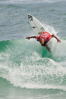 Bobby Martinez (USA) SNAPPER ROCKS, Queensland/Australia (Thursday, March 4, 2010) - Pumping three-to-five foot (1 - 1.5 metre) pulsed down the point at Snapper Rocks today, setting the stage for the world's best surfers to unleash upon the warm-water walls at the Quiksilver Pro Gold Coast presented by Land Rover and the Roxy Pro Gold Coast.     The opening event of the 2010 ASP World Tour, the Quiksilver Pro Gold Coast saw Round 4 as well as the Quarterfinals completed today, with some massive upsets as the world's best surfers    Dane Reynolds (USA), 24, current ASP World No. 10, was slow to start in his Quiksilver Pro Gold Coast campaign, but joined the giant-killing spree this afternoon, dispatching of 2009 ASP World Runner-Up and defending event winner Joel Parkinson (AUS), 28, in their Quarterfinal bout.  Reynolds will face Jordy Smith (ZAF), 22, in the Semifinals when the Quiksilver Pro Gold Coast resumes.      Smith caused a major upset in Round 4 earlier today, eliminating former nine-time ASP World Champion Kelly Slater (USA), 38, with electric surfing and smart tactics.     Smith would go on to defeat current ASP World No. 3 Bede Durbidge (AUS), 27, in the Quarterfinals.      Taj Burrow (AUS), 31, current ASP World No.4, continued his rampage at the Quiksilver Pro Gold Coast today, advancing through to the Semifinals and continuing his flawless competitive run over the past two months. Collecting wins at Pipeline and Burleigh Heads, Burrow will look to keep the roll going into the business end of the Quiksilver Pro Gold Coast.   Burrow will face Bobby Martinez (USA), 27, in the opening Semifinal bout when competition resumes.      Mick Fanning (AUS), 28, reigning two-time ASP World Champion, went down today in a hard-fought Round 4 against compatriot Kai Otton (AUS), 30. Otton was subsequently eliminated by Martinez in the Quarterfinals.   Photo: joliphotos.com