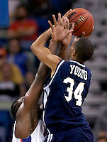 NEW ORLEANS, LA. 3/15/07-Florida's Chris Richard gets his hands in the face of Jackson State's Julius Young during first half action, Friday in the first round of the NCAA Tournament at the New Orleans Arena. COLIN HACKLEY PHOTO
