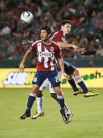 Chivas midfielder Paulo Nagamura (26) haeds the ball during the first half of the game between Chivas USA and the New England Revolution at the Home Depot Center in Carson, CA, on September 10, 2010. Chivas USA 2, New England Revolution 0.