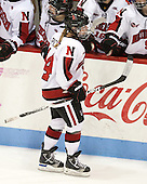Casey Pickett (NU - 14) - The Northeastern University Huskies defeated Boston College Eagles 4-3 to repeat as Beanpot champions on Tuesday, February 12, 2013, at Matthews Arena in Boston, Massachusetts.
