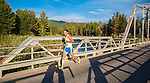 runner in the missoula montana marathon crossing the maclay bridge over the bitterroot rive in missoula, montana