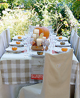 An outdoor table laid for a themed Halloween dinner