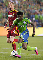 Obafemi Martins, right, Obafemi Martins battles Nat Borchers of Real Salt Lake for the ball during play at CenturyLink Field in Seattle Friday September 13, 2013. The Sounders won the match 2-0.