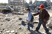 Rafah, Gaza.   Children walk by a destroyed police station hit by the Israeli Air Force in the town of Rafah.  After the  Israeli military campaign known as Operation Cast Lead, in this small  town along the Gaza-Egypt border the people is still struggling back to their lives. The conflict resulted in between 1,166 and 1,417 Palestinian and 13 Israeli deaths (4 from friendly fire).   (PHOTO: MIGUEL JUAREZ LUGO)