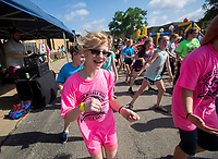NWA Democrat-Gazette/JASON IVESTER<br /> Darryan (cq) Fino (cq), fifth-grader, dances with friends Thursday, May 18, 2017, during the Fun and Field Day at Old High Middle School in Bentonville. Next Friday is the last day of school for Bentonville students.