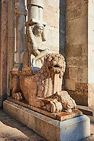 Lions with Atlas on their back holdingup a column that supports the canopy above the main portal of the 12th century Romanesque Ferrara Duomo, Italy