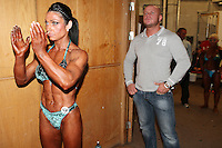 23/10/2010. Irish female physique and figure fitness national championships.  Sophia Mc Namara (1st place winner) from Limerick is pictured pumping up backstage during the female physique category as part of the 2010 RIBBF national bodybuilding championships at the University of Limerick Concert Hall, Limerick, Ireland. Picture James Horan