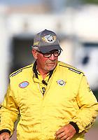 Apr 25, 2014; Baytown, TX, USA; NHRA Safety Safari crew member during qualifying for the Spring Nationals at Royal Purple Raceway. Mandatory Credit: Mark J. Rebilas-
