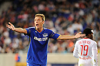 Jimmy Conrad (12) of the Kansas City Wizards looks for a call from the assistant referee during a Major League Soccer (MLS) match against the New York Red Bulls at Red Bull Arena in Harrison, NJ, on October 02, 2010.