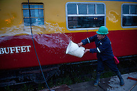 Felix Plaza cleans one of the three passenger cars at Chilca Station before the 6:30 a.m. departure.