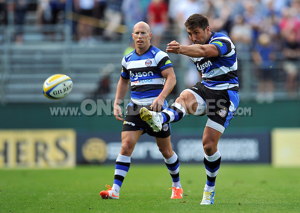 Gavin Henson kicks for touch. Pre-season friendly match, between Bath Rugby and the Scarlets on August 16, 2014 at the Recreation Ground in Bath, England. Photo by: Patrick Khachfe / Onside Images