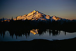 This perfect reflection of Glacier Peak taken just prior to sunset, reveals the tremendous beauty of Glacier and its surrounding landscape, Washington.
