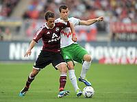 FUSSBALL   1. BUNDESLIGA  SAISON 2011/2012   6. Spieltag 1 FC Nuernberg - SV Werder Bremen         17.09.2011 Markus Feulner (li, 1 FC Nuernberg) gegen Lukas Schmitz (re, SV Werder Bremen)