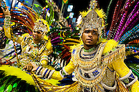 The flag bearer and the master of ceremony of Imperatriz samba school perform during the Carnival parade at the Sambadrome in Rio de Janeiro, Brazil, 20 February 2012. The Carnival in Rio de Janeiro, considered the biggest carnival in the world, is a colorful, four day celebration, taking place every year forty days before Easter. The Samba school parades, featuring thousands of dancers, imaginative costumes and elaborate floats, are held on the Sambadrome, a purpose-built stadium in downtown Rio. According to costumes, flow, theme, band music quality and performance, a single school is declared the winner of the competition.