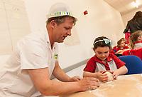 ASDA Newark baker Mark Smith shows Rainbow Megan Horbury, 6, how to knead dough