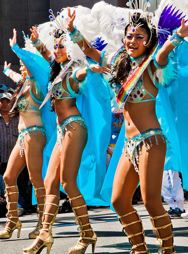 Samba ladies show off their outfits & dance along the streets of Tokyo during its Samba Parade.