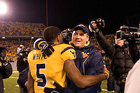 Rich Rodriguez congratulates quarterback Pat White after the West Virginia Mountaineers defeated the Louisville Cardinals 38-31 on November 08, 2007 at Mountaineer Field, Morgantown, West Virginia. .