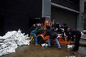 New York, New York.October 30, 2012..Workers push a massive generator in to an office building in lower Manhattan after Hurricane Sandy.