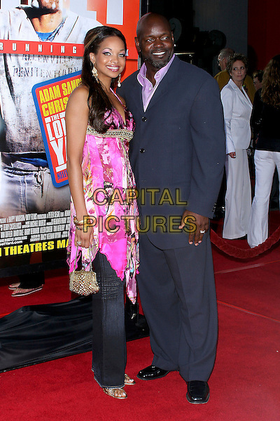 "EMMITT SMITH.World Premiere of ""The Longest Yard"" held at Grauman's Chinese Theatre..May 19th, 2005.Photo Credit: Jacqui Wong/AdMedia.full length blue suit pink top gold purse.www.capitalpictures.com.sales@capitalpictures.com.© Capital Pictures."