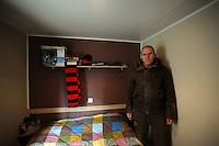 Terremoto del L'Aquila un' anno dopo. Earthquake L'Aquila one year after.Rossano Perilli nella sua stanza. Rossano Perilli in his room....