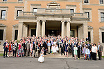Following their afternoon reception, invited guests gathered on the steps of Sleepy Hollow Country Club for a group photo and to see the couple off.
