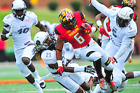 Terrapins Ty Johnson breaks the tackle for a big gain. Maryland routed Howard 52-13 during home season opener at Capital One Field in College Park, MD on Saturday, September 3, 2016.  Alan P. Santos/DC Sports Box