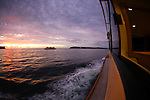 Sunrise onboard the Manly Sydney Ferry on this way to Circular Quay passing close by the Sydney Heads, crossing with an other Manly Sydney Ferries.