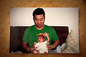 File photograph of Thomas Kim with his son Brady who the first baby to a western couple delivered on February 2nd 2007 at the Akanksha Infertility Centre &amp; IVF Centre in Anand, Gujarat, India.