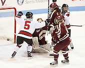 Kelly Wallace (NU - 5), Paige Savage (NU - 28) - The Northeastern University Huskies defeated Boston College Eagles 4-3 to repeat as Beanpot champions on Tuesday, February 12, 2013, at Matthews Arena in Boston, Massachusetts.