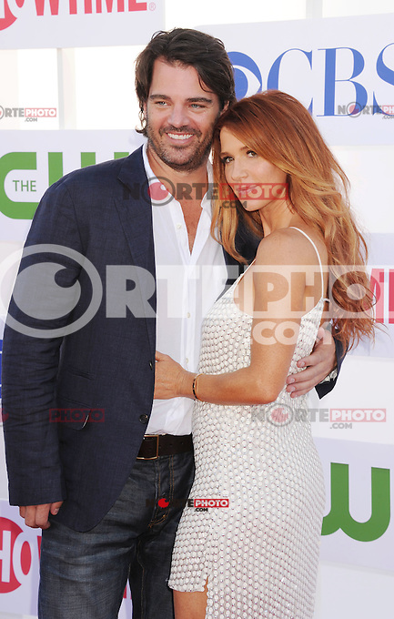 BEVERLY HILLS, CA - JULY 29: Adam Kaufman and Poppy Montgomery arrive at the CBS, Showtime and The CW 2012 TCA summer tour party at 9900 Wilshire Blvd on July 29, 2012 in Beverly Hills, California. /NortePhoto.com<br />