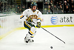 12 December 2009: University of Vermont Catamount defenseman Patrick Cullity, a Senior from Tewsbury, MA, in first period action against the St. Lawrence University Saints at Gutterson Fieldhouse in Burlington, Vermont. The Catamounts shut out their former ECAC rival Saints 3-0. Mandatory Credit: Ed Wolfstein Photo