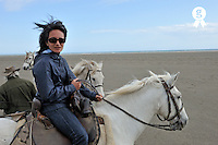 Woman riding camargue horse on beach (Licence this image exclusively with Getty: http://www.gettyimages.com/detail/106905613 )