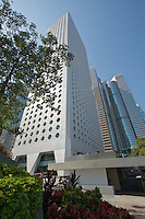 Jardine House and Exchange Square, in Hong Kong's Central district. Jardine House was completed in 1972 and at 178m tall was the tallest building in Asia