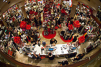 Hordes of shoppers inside Macy's in New York looking for bargains on Black Friday, the day after Thanksgiving, Friday, November 25, 2011. Many retailers opened their doors on Thanksgiving or opened up for Black Friday the night before extending the shopping day into over 24 hours. (© Frances M. Roberts)