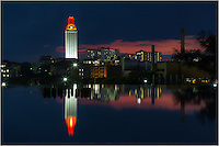 After a UT football win, the UT Tower stands out from the Austin skyline because the top of the tower is lit orange.