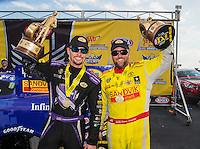 Sep 25, 2016; Madison, IL, USA; NHRA funny car driver Jack Beckman (left) and teammate top fuel driver Shawn Langdon celebrate after winning the Midwest Nationals at Gateway Motorsports Park. Mandatory Credit: Mark J. Rebilas-USA TODAY Sports